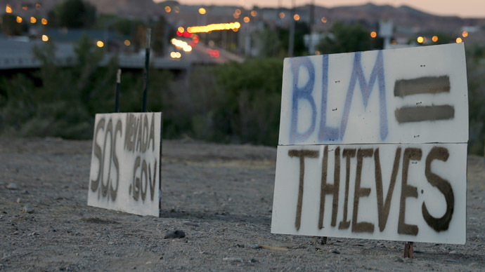 Protest signs are posted along US. highway 170 protesting the closure of thousands of acres of Bureau of Land Management land that has been temporarily closed to round-up illegal cattle that are grazing south of Mesquite Nevada on April 10, 2014 in Mesquite, Nevada. (George Frey/Getty Images/AFP)