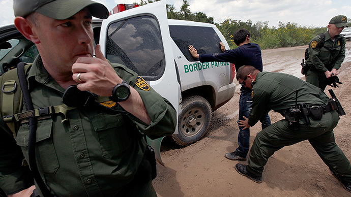 A Border Patrol agent searches an undocumented immigrant apprehended near the Mexican border (Scott Olson / Getty Images / AFP)