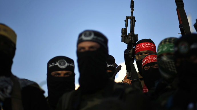 Palestinians militants from various armed factions, including Hamas, attend a news conference in Gaza City June 17, 2014. (Reuters/Mohammed Salem)