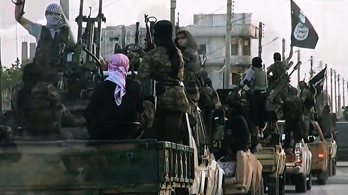 An image grab taken from a propaganda video released on March 17, 2014 by the Islamic State of Iraq and the Levant (ISIL)'s al-Furqan Media allegedly shows ISIL fighters driving on a street in the northern Syrian City of Homs (AFP Photo)