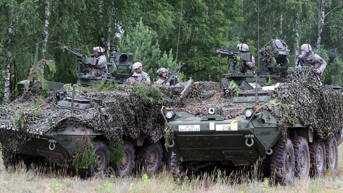 Soldiers from the US Pennsylvania National Guard take part in a field training exercise during the first phase Saber Strike 2014, at the Rukla military base, Lithuania, on June 14, 2014. (AFP Photo / Petras Malukas)