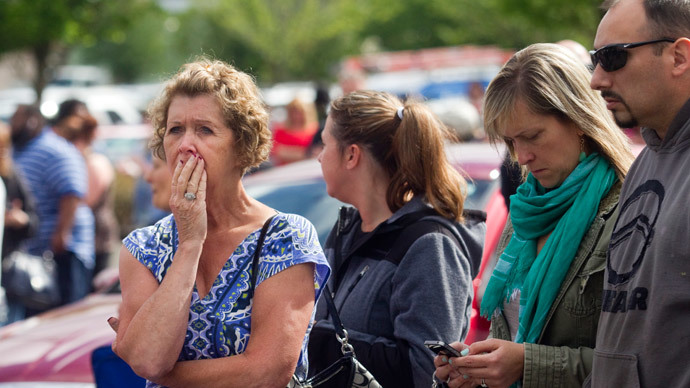 Parents of Reynolds High School students react as they wait to be reunited with their children after a school shooting June 10, 2014 in Troutdale, Oregon. (Natalie Behring / Getty Images / AFP)