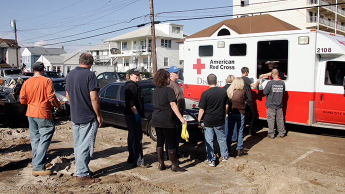 ARCHIVE PHOTO: Residents who returned to their homes damaged by Hurricane Sandy line up for a hot meal served from a red Cross vehicle on Samson Avenue in Seaside Heights, New Jersey November 12, 2012 (Reuters / Tom Mihalek)