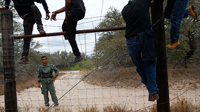 People are taken into custody by the U.S. Border Patrol near Falfurrias, Texas (Reuters / Eric Thayer)