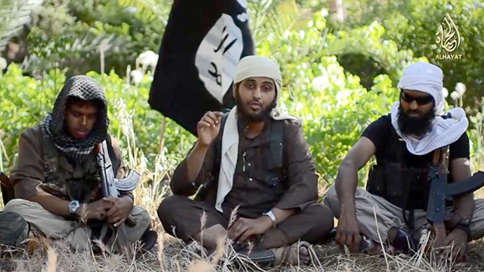 "A screenshot of an ISIS recruitment video using Western fighters from YouTube video by الإعلام الجهادي (""Jihadist media"")"