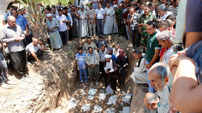 Mourners pray during a funeral in Kirkuk, June 23, 2014 (Reuters / Ako Rasheed)