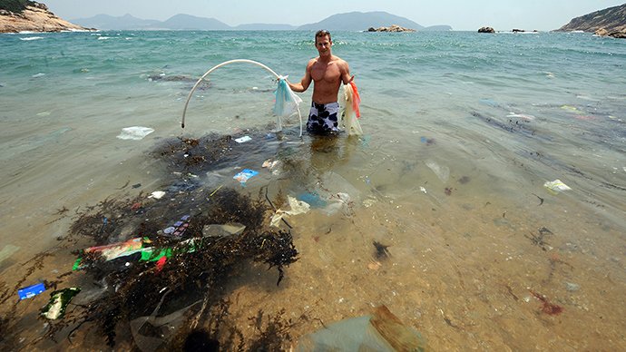 Entrepreneur and conservationist who lives in Hong Kong, displays rubbish on a beach on the south side of Hong Kong which has been left uncleaned (AFP Photo / Mike Clarke)