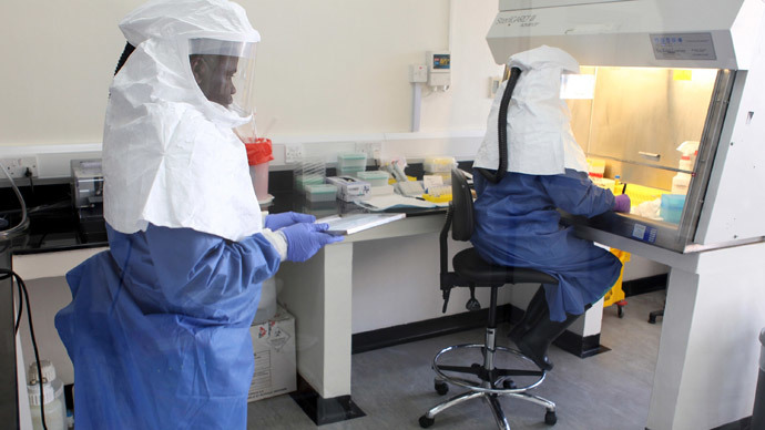 Doctors work in a laboratory on collected samples of the Ebola virus at the Centre for Disease Control in Entebbe, about 37 km (23 miles) southwest of Uganda's capital Kampala.(Reuters / Edward Echwalu)