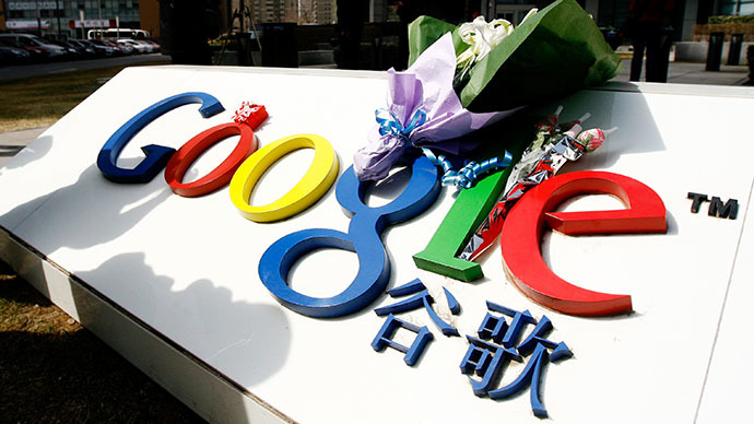A bouquet of flowers lies on the Google logo outside the company's China head office in Beijing on March 23, 2010 after the US web giant said it would no longer filter results and was redirecting mainland Chinese users to an uncensored site in Hong Kong — effectively closing down the mainland site. (AFP Photo / Li Xin)