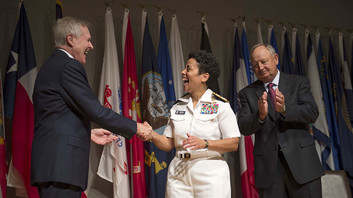 Secretary of the Navy Ray Mabus (L) congratulates Admiral Michelle Howard (C) during her promotion ceremony in this handout photo provided by the U.S. Navy in Arlington, Virginia July 1, 2014/Reuters