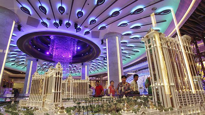 Visitors look at a model of Galaxy Macau resort inside Galaxy Macau in Macau (Reuters / Paul Yeung)