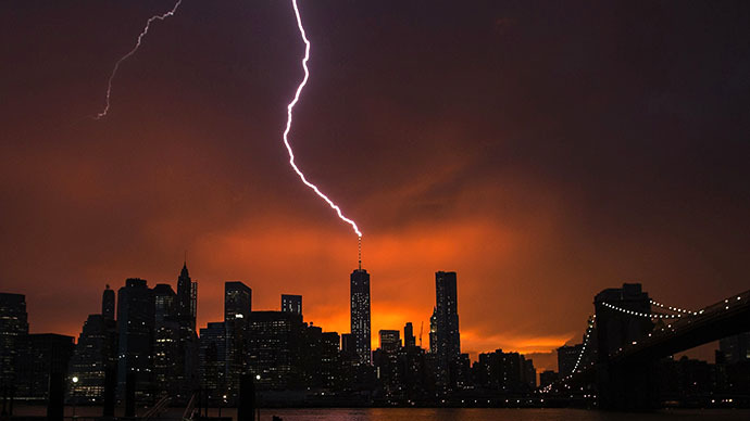 Lightning strikes One World Trade Center in Manhattan as the sun sets behind the city after a summer storm in New York July 2, 2014. (Reuters / Lucas Jackson)