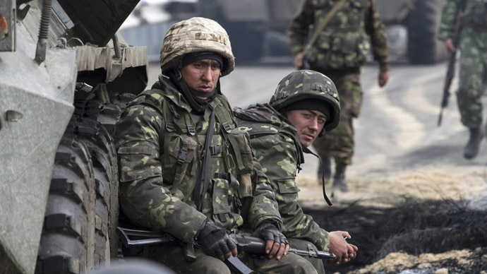 Ukrainian soldiers look on at a Ukrainian checkpoint near the eastern town of Slaviansk May 2, 2014. (Reuters/Baz Ratner)