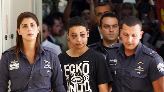 Tarek Abu Khdeir (C), a 15-year-old American of Palestinian descent and a cousin of Mohammad Abu Khdeir, the recently murdered youth, is escorted by Israeli prison guards during an appearance at Jerusalem magistrate's court July 6, 2014. (Reuters/Ronen Zvulun)