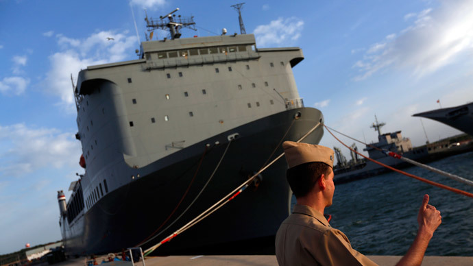 A U.S. navy personnel gestures in front of the U.S. MV Cape Ray ship docked at the naval airbase in Rota, near Cadiz, southern Spain April 10, 2014.(Reuters / Marcelo del Pozo)
