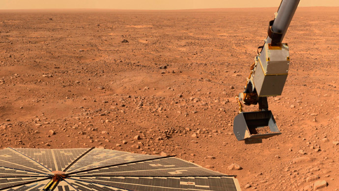NASA's Phoenix Mars Lander's solar panel and the lander's Robotic Arm with a sample in the scoop are seen in this image taken June 10, 2008 by the lander's Surface Stereo Imager. (Reuters / NASA)