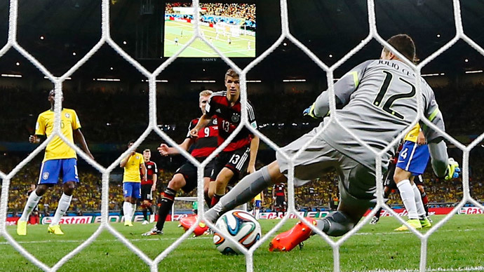 Germany's Andre Schuerrle (9) scores their sixth goal during their 2014 World Cup semi-finals against Brazil at the Mineirao stadium in Belo Horizonte July 8, 2014. (Reuters / Kai Pfaffenbach)