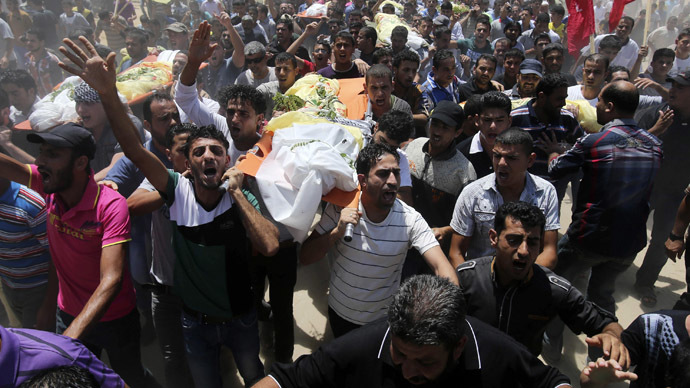 Palestinians carry the bodies of members of the Kaware family that hospital officials said were killed in an Israeli air strike on their house, during their funeral in Khan Younis in the southern Gaza Strip July 9, 2014. (Reuters)