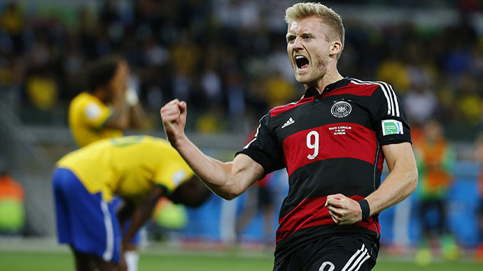 Germany's Andre Schuerrle celebrates scoring his team's sixth goal against Brazil during their 2014 World Cup semi-finals at the Mineirao stadium in Belo Horizonte July 8, 2014. (Reuters/Damir Sagolj)