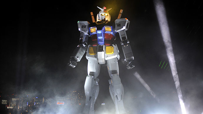 The 18-metre tall statue of popular TV animation hero Gundam is lit up during the opening ceremony at a Tokyo park. (AFP Photo / Yoshikazu Tsuno)