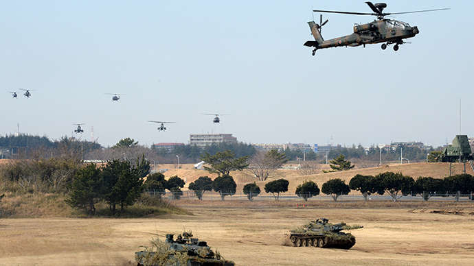 Japanese Ground Self Defense forces' helicopters fly over tanks during the new year exercise in Narashino in Chiba prefecture, suburban Tokyo (AFP Photo / Yoshikazu Tsuno)
