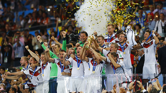 Germany's players lifts the World Cup trophy as they celebrate their 2014 World Cup final win against Argentina at the Maracana stadium in Rio de Janeiro July 13, 2014. (Reuters / Darren Staples)