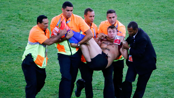 Stewards carry a supporter off the pitch during the 2014 World Cup final between Germany and Argentina at the Maracana stadium in Rio de Janeiro July 13, 2014.(Reuters / Leonhard Foeger)