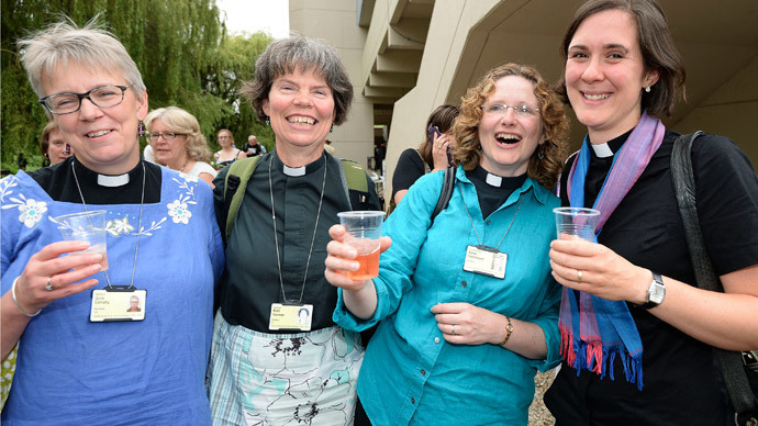 Women react after the Synod session which approved the consecration of women bishops, in York July 14, 2014. (Reuters / Nigel Roddis)