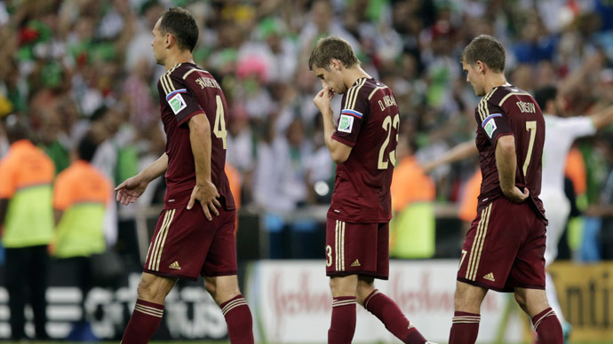 Russia's Sergey Ignashevich (L), Dmitry Kombarov and Igor Denisov react as they walk off the field after the match against Algeria at the 2014 World Cup Group H soccer match at the Baixada arena in Curitiba June 26, 2014. (Reuters/Henry Romero)