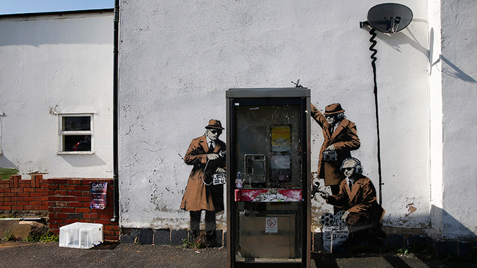 Graffiti art is seen on a wall near the headquarters of Britain's eavesdropping agency, Government Communications Headquarters, known as GCHQ, in Cheltenham, western England (Reuters / Eddie Keogh)