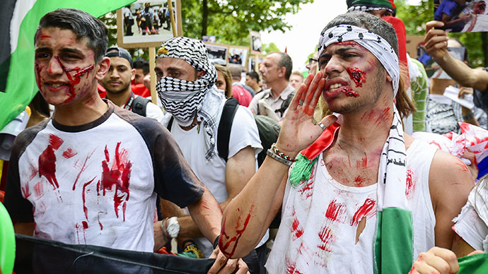 Protesters sport fake injuries during a demonstration in Brussels on July 19, 2014, to protest Israel's military campaign in Gaza and show their support to the Palestinian people. (AFP Photo / Laurie Dieffembacq)