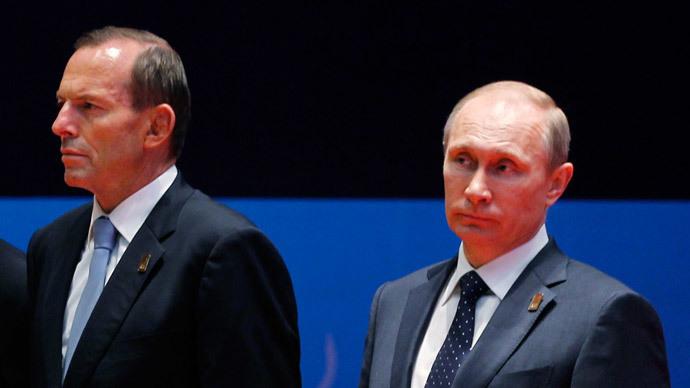 Australia's Prime Minister Tony Abbott (L) and Russia's President Vladimir Putin.(AFP Photo / Beawiharta)