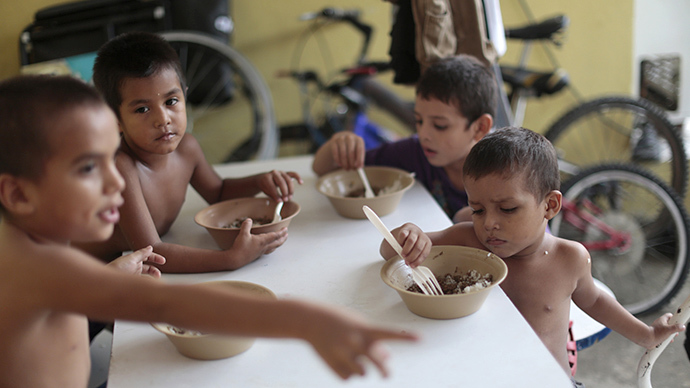 Honduran children have meals at the Todo por ellos (All for them) immigrant shelter in Tapachula, Chiapas, in southern Mexico. (Reuters /  Jorge Lopez)