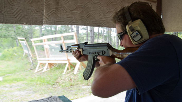 A man fires an AK-47 semi-automatic rifle at the St. Croix Rod and Gun Club in Hudson, Wisconsin. (AFP Photo / Karen Bleier)