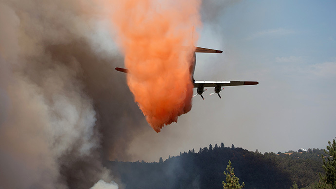 "An air tanker drops retardant on the fast-moving wildfire called ""Sand Fire"" near Plymouth, California July 26, 2014. (Reuters / Max Whittaker)"