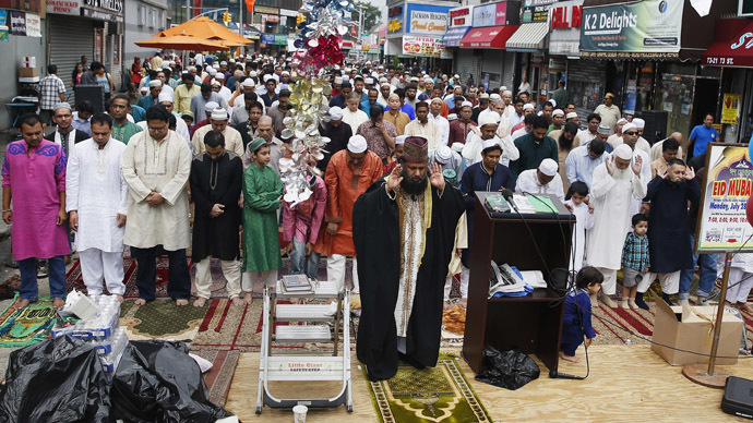 Muslim worshippers pray during Eid al-Fitr services in the Queens borough of New York July 28, 2014. (Reuters/Shannon Stapleton)