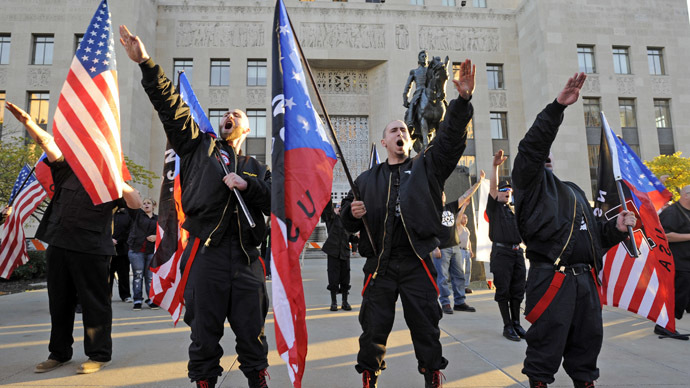 "Members of the National Socialist Movement ""salute"" a speaker during a neo-Nazi rally at the Jackson County Courthouse November 9, 2013 in Kansas City, Missouri. (Reuters/Dave Kaup)"