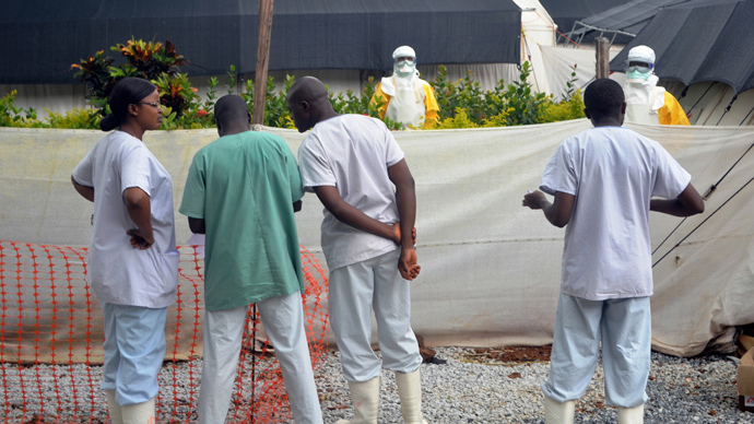 Members of Doctors Without Borders (MSF) wear protective gear at the isolation ward of the Donka Hospital in Conakry (AFP Photo / Cellou Binani)