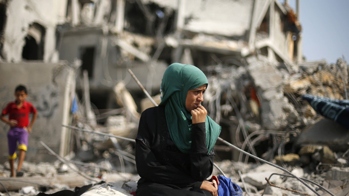 A Palestinian woman sits on the remains of her destroyed house after returning to Beit Hanoun town, which witnesses said was heavily hit by Israeli shelling and air strikes during the Israeli offensive, in the northern Gaza Strip August 5, 2014.  (Reuters / Suhaib Salem)