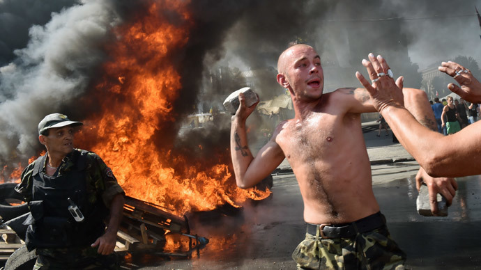 Maidan self-defence activists clash with fighters of Kiev-1 volunteer battalion on Independence Square in Kiev on August 7, 2014.(AFP Photo / Sergei Supinsky)
