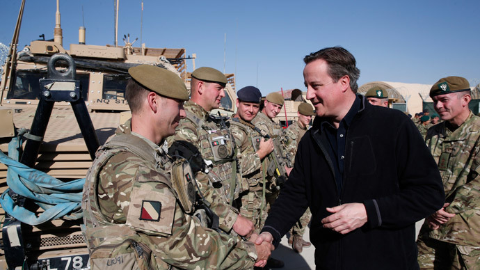 Britain's Prime Minister David Cameron (R) talks to British soldiers during a visit at Camp Bastion, outside Lashkar Gah, the provincial capital of Helmand province in southern Afghanistan.(AFP Photo / Lefteris Pitarakis)