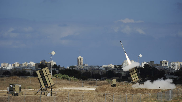 "A missile is launched by an ""Iron Dome"" battery, a missile defence system designed to intercept and destroy incoming short-range rockets and artillery shells, in the southern Israeli city of Ashdod on July 18, 2014.(AFP Photo / David Buimovitch)"