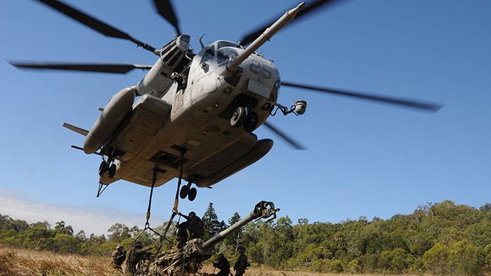 US Navy handout photo of a helicopter lifting a howitzer in Shoalwater Bay, Australia (Reuters)