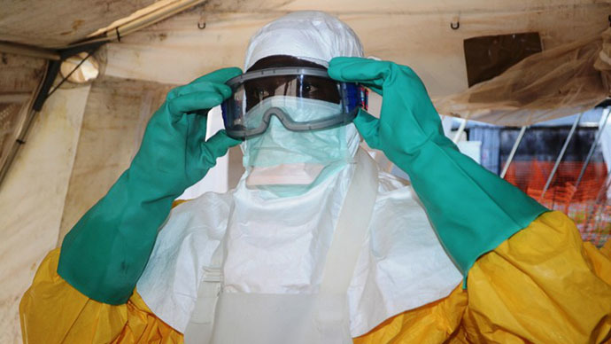 A file photo taken on June 28, 2014 shows a member of Doctors Without Borders (MSF) putting on protective gear at the isolation ward of the Donka Hospital in Conakry, where people infected with the Ebola virus are being treated. (AFP Photo / Cellou Binani)