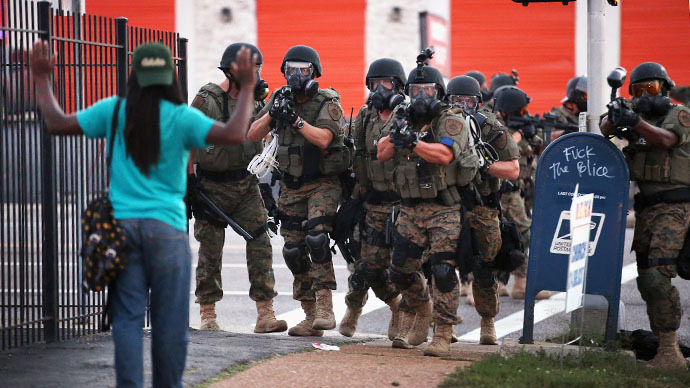 Police force protestors from the business district into nearby neighborhoods on August 11, 2014 in Ferguson, Missouri. (AFP Photo / Getty Images / Scott Olson)