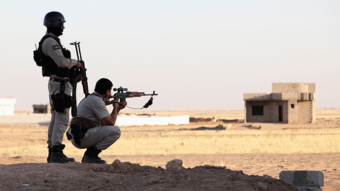 Kurdish Peshmerga troops participate in an intensive security deployment against Islamic State militants in a village on the outskirts of the province of Nineveh near the border province of Dohuk, August 9, 2014 (Reuters / Ari Jalal)