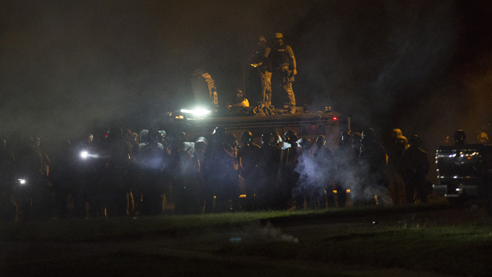 Riot police clear a street from demonstrators in Ferguson, Missouri August 13, 2014. (Reuters / Mario Anzuoni)