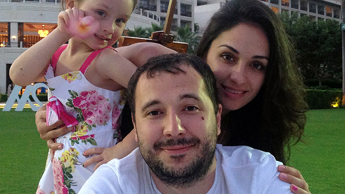Undated family photo taken in Sochi shows Roman Seleznev (C), the son of a Russian lawmaker from the Liberal-Democratic Party (LDPR), posing with his partner Anna Otisko (R) and their daughter (AFP Photo / HO)