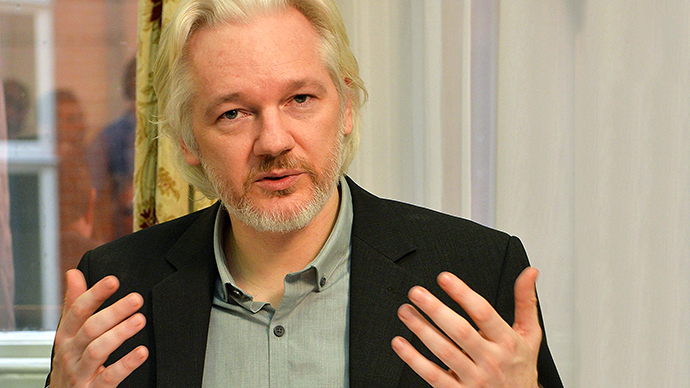WikiLeaks founder Julian Assange gestures during a press conference inside the Ecuadorian Embassy in London on August 18, 2014 where Assange has been holed up for two years. (AFP Photo / John Stillwell)