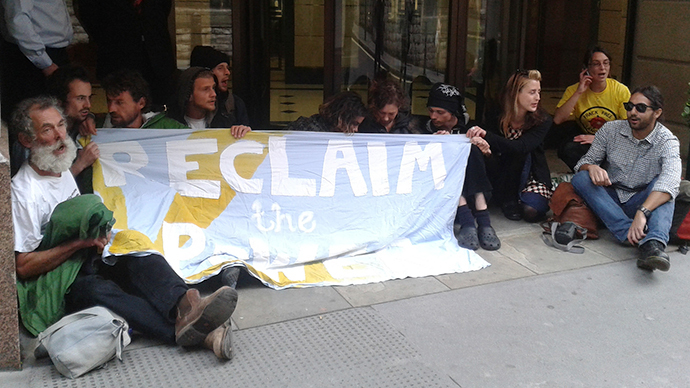As part of a nationwide day of direct action, campaigners have occupied a government building  and blockaded both entrances to an energy firm. (Image from flickr.com / Reclaim The Power)